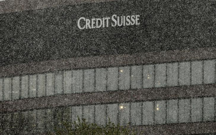 The logo of Swiss bank Credit Suisse is seen at an office building during heavy snowfall in Zurich, Switzerland April 26, 2017. REUTERS/Arnd Wiegmann/Files