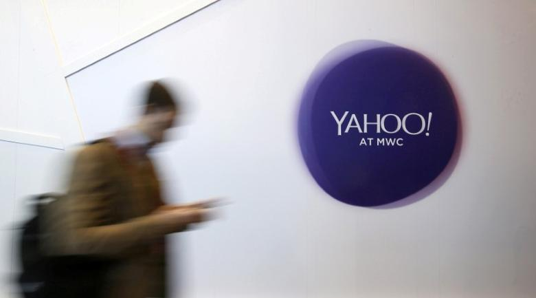 A man walks past a Yahoo logo during the Mobile World Congress in Barcelona, Spain, February 24, 2016. REUTERS/Albert Gea/File Photo/File Photo