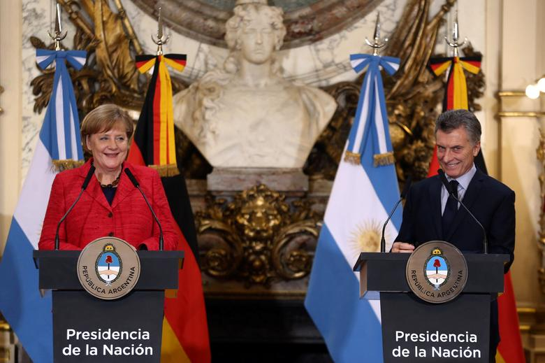 Germany's Chancellor Angela Merkel and Argentina's President Mauricio Macri smile during a news conference at the Casa Rosada Presidential Palace in Buenos Aires, Argentina, June 8, 2017. REUTERS/Marcos Brindicci