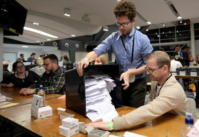 Ballot boxes arrive for counting, at a counting centre for Britain's general election, in Brighton. REUTERS/Adam Holt