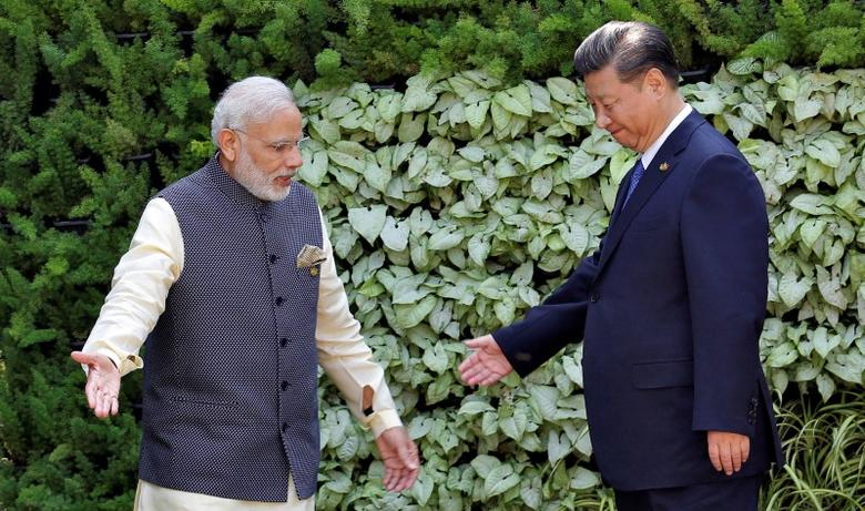 FILE PHOTO: Prime Minister Narendra Modi (L) and Chinese President Xi Jinping leave after a group picture during BRICS (Brazil, Russia, India, China and South Africa) Summit in Benaulim, in Goa, India, October 16, 2016. REUTERS/Danish Siddiqui/Files