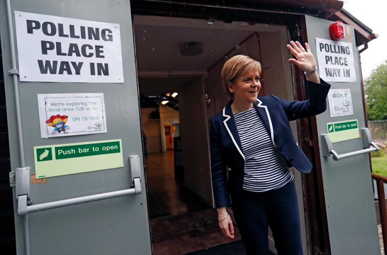Nicola Sturgeon, First Minister of Scotland, waves after voting in Glasgow. REUTERS/Russell Cheyne