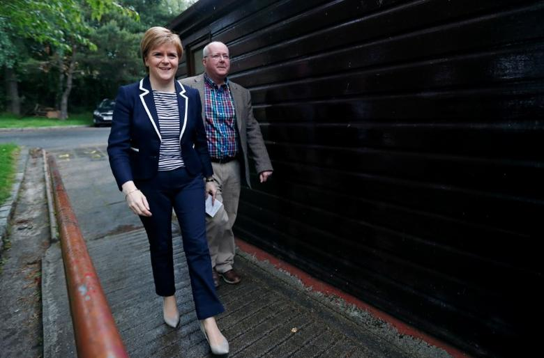 First Minister of Scotland Nicola Sturgeon and her husband Peter Murrell are seen after voting in Glasgow, Britain June 8, 2017. REUTERS/Russell Cheyne