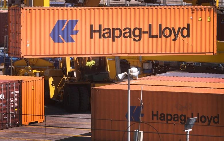 FILE PHOTO: A port worker moves a Hapag-Lloyd container at the Port of Bilbao on the second day of a three-day strike by Spanish port workers to protest the reform of operations, aimed at liberalising hiring practices, in Santurtzi, northern Spain, June 7, 2017. REUTERS/Vincent West/File Photo