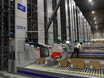 Workers on automated systems at the Hudson's Bay Company distribution centre in Toronto, Ontario, Canada May 29, 2017. Picture taken May 29, 2017.  REUTERS/Fred Thornhill