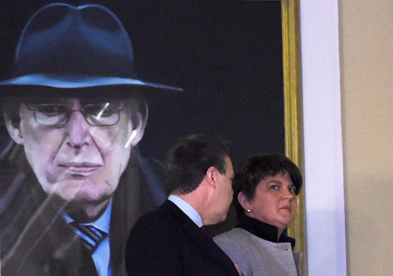 FILE PHOTO: Northern Ireland First Minister and leader of the Democratic Unionist Party Arlene Foster walks past a portrait of Ian Paisley after speaking at Parliament Buildings in Stormont in Belfast, Northern Ireland, January 16, 2017. REUTERS/Clodagh Kilcoyne/File Photo