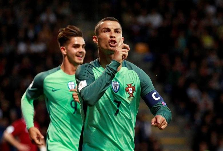 Football Soccer - Latvia vs Portugal - 2018 World Cup Qualifying European Zone - Group B - Skonto Stadium, Riga, Latvia - June 9, 2017   Portugal's Cristiano Ronaldo celebrates scoring their first goal    Reuters / Kacper Pempel