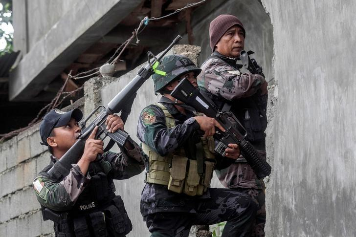 A joint group of police and military forces on positions while conducting a house to house search as part of clearing operations in different sections of Marawi city, Philippines June 7, 2017. REUTERS/Stringer
