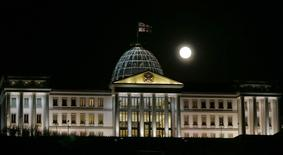 The supermoon is pictured over the Presidential palace in Tbilisi, Georgia November 14, 2016. REUTERS/David Mdzinarishvili - RTX2TM6K