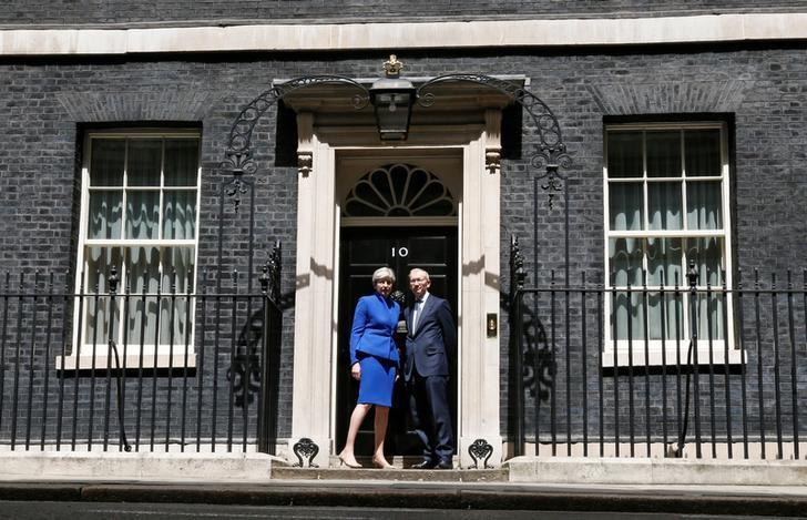Britain's Primer Minister Theresa May and her husband pose at number 10 Downing Street in London, Britain June 9, 2017. REUTERS/Stefan Wermuth