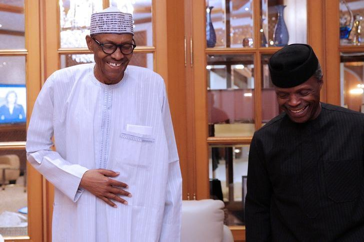 Nigerian President Muhammadu Buhari (L) smiles next to his deputy Yemi Osibanjo in Abuja, Nigeria, May 7, 2017. Bayo Omoboriowo/Presidential office/Handout via Reuters/Files