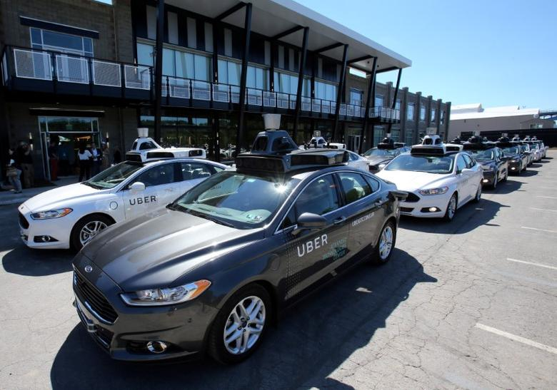 FILE PHOTO: A fleet of Uber's Ford Fusion self driving cars are shown during a demonstration of self-driving automotive technology in Pittsburgh, Pennsylvania, U.S. on September 13, 2016.  REUTERS/Aaron Josefczyk/File Photo