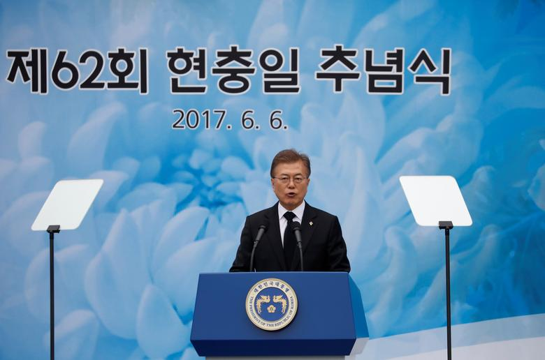 South Korean President Moon Jae-in delivers a speech during a ceremony marking Korean Memorial Day at the National Cemetery in Seoul, South Korea, June 6, 2017.   REUTERS/Kim Hong-Ji