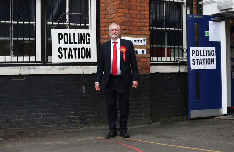 Jeremy Corbyn leaves after voting at a polling station in Islington, London. REUTERS/Neil Hall