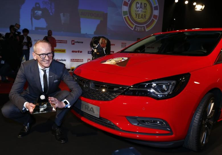 FILE PHOTO - Karl-Thomas Neumann, CEO of Opel Group poses with the Car of the Year award next to the Opel Astra during the presentation ahead of the 86th International Motor Show at Palexpo in Geneva, Switzerland, February 29, 2016. REUTERS/Denis Balibouse