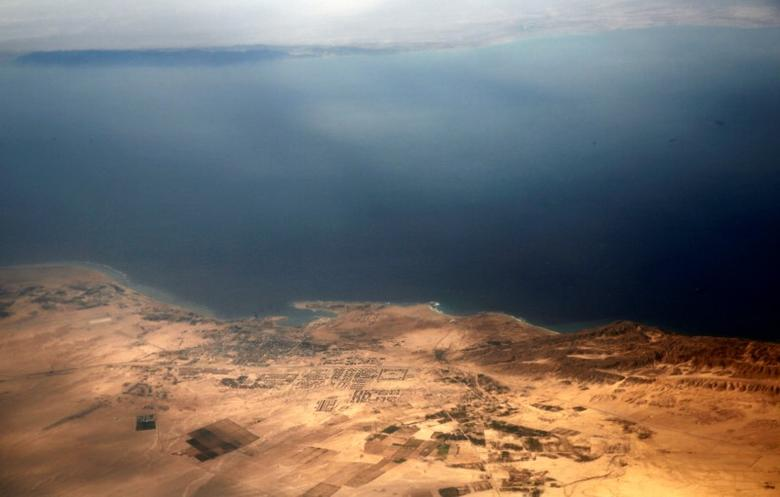 An aerial view of the coast of the Red Sea and the two islands of Tiran and Sanafir is pictured through the window of an airplane near Sharm el-Sheikh, Egypt November 1, 2016. Picture taken November 1, 2016. REUTERS/Amr Abdallah Dalsh/Files