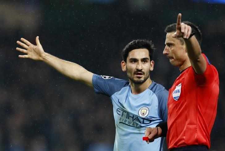 Britain Football Soccer - Manchester City v Celtic - UEFA Champions League Group Stage - Group C - Etihad Stadium, Manchester, England - 6/12/16 Manchester City's Ilkay Gundogan speaks with referee Slavko Vincic Action Images via Reuters / Jason Cairnduff Livepic EDITORIAL USE ONLY.