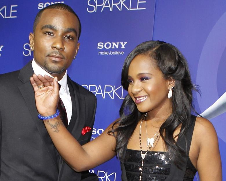FILE PICTURE: Bobbi Kristina Brown, daughter of the late singer Whitney Houston, waves while arriving with boyfriend Nick Gordon at the premiere of the new film ''Sparkle'', in Hollywood, California August 16, 2012. REUTERS/Fred Prouser/File Photo