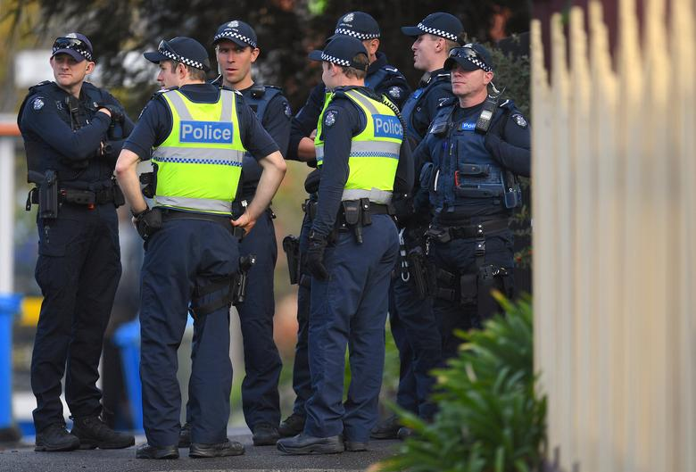 FILE PHOTO - Australian police stand at the site of a siege at the Buckingham Serviced Apartments in Melbourne, Australia, June 6, 2017.   AAP/Julian Smith/via REUTERS