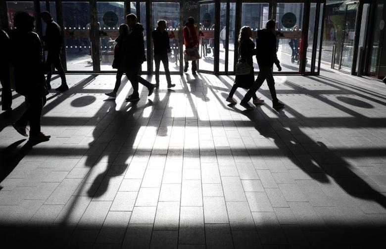 People's shadows are seen as shoppers are silhouetted in the bright sunshine at the Westfield shopping centre, Stratford, London January, 28, 2017.     REUTERS/Russell Boyce
