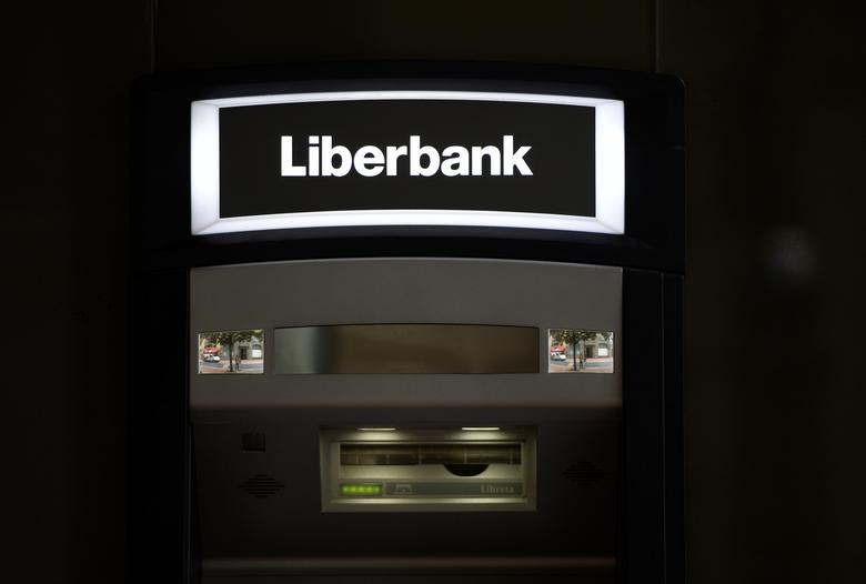 A cash dispenser is seen at a branch of Liberbank in Oviedo, Spain, June 9, 2017. REUTERS/Eloy Alonso