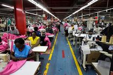 Employees work on the manufacturing line at the United Aryan Export Processing Zone textile factory in Nairobi, Kenya April 13, 2017. REUTERS/Baz Ratner/File Photo