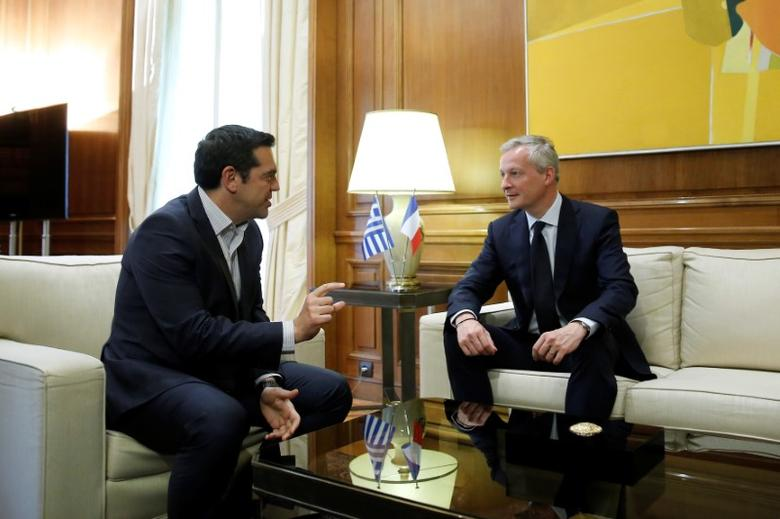 Greek Prime Minister Alexis Tsipras (L) meets with French Finance Minister Bruno Le Maire at his office in Maximos Mansion in Athens, Greece, June 12, 2017. REUTERS/Costas Baltas