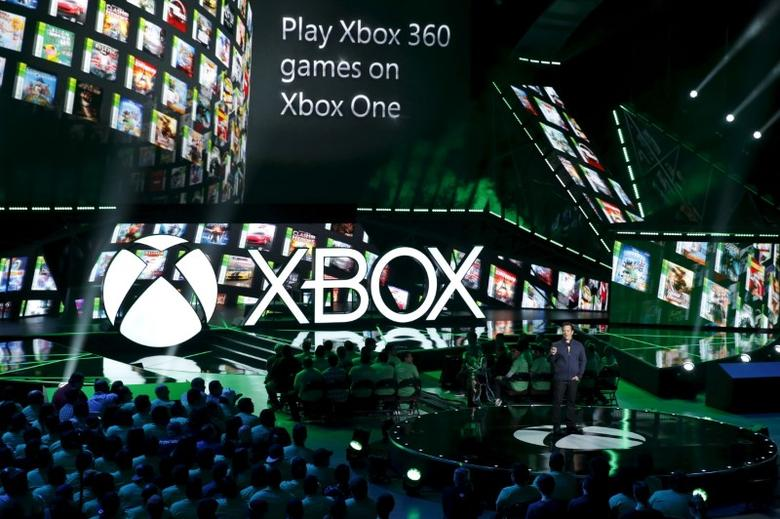 Phil Spencer, head of Xbox, announces backwards compatibility to play all Xbox 360 games on the Xbox One during game publisher Microsoft's Xbox media briefing before the opening day of the Electronic Entertainment Expo, or E3, in Los Angeles, California, United States, June 15, 2015. REUTERS/Lucy Nicholson  - RTX1GMBI