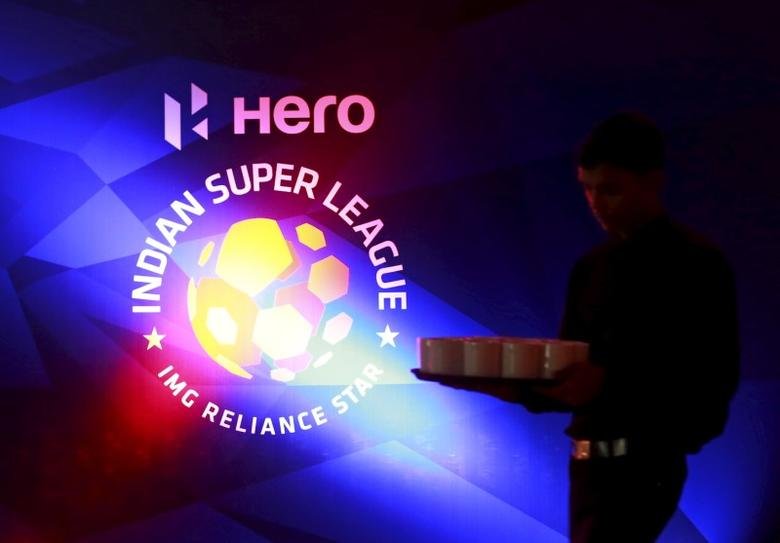 FILE PHOTO - A waiter walks past a logo of Indian Super League before a news conference during the domestic player auction and draft in Mumbai, India, July 10, 2015. REUTERS/Danish Siddiqui