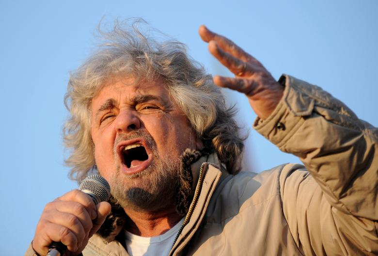 FILE PHOTO: Five-Star Movement leader and comedian Beppe Grillo gestures during a rally in Turin, Italy February 16, 2013. REUTERS/Giorgio Perottino/File Photo