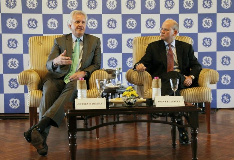 FILE PHOTO: General Electric Co Chief Executive Jeff Immelt (L) speaks with the media as John Flannery, head of GE in India, watches in New Delhi February 22, 2013. REUTERS/B Mathur