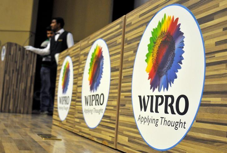 Stewards are seen behind desks with the logo of India's third-largest software services firm Wipro Ltd inside the company's headquarters in Bengaluru, India, October 21, 2016. REUTERS/Abhishek N. Chinnappa