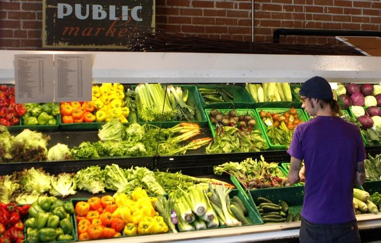 A customer looks over produce at the Phoenix Public Market in Phoenix, Arizona August 23, 2011. The first readout of the 2011 . REUTERS/Joshua Lott