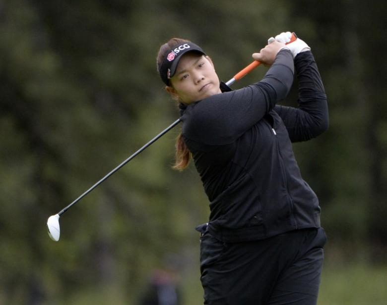 FILE PHOTO: Aug 28, 2016; Calgary, Alberta, CAN;  Ariya Jutanugarn of Thailand hits her second shot on the 1st hole during the final round of the Canadian Pacific Women's Open at Priddis Greens Golf and Country Club. Eric Bolte-USA TODAY Sports  / Reuters