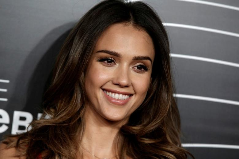 FILE PHOTO - Actress and founder of the Honest Company Jessica Alba poses as she arrives for the 20th Annual Webby Awards in Manhattan, New York, U.S. on May 16, 2016. REUTERS/Mike Segar/File Photo
