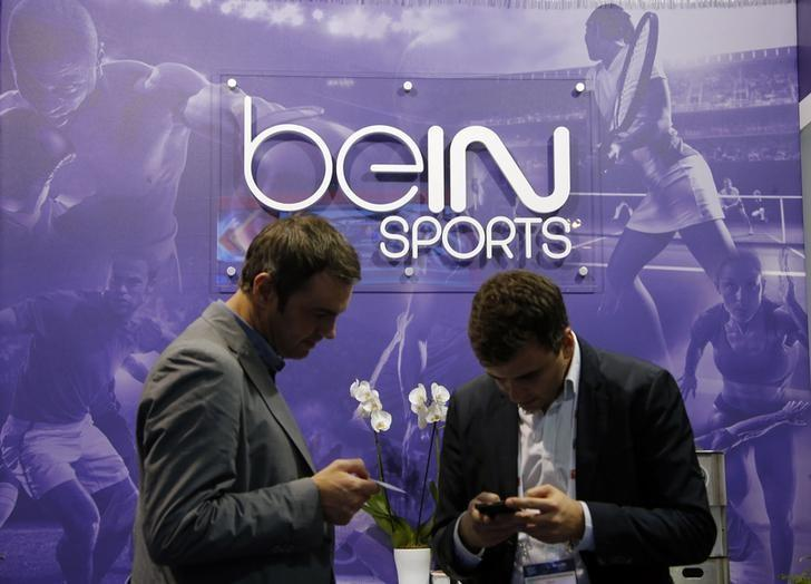 Visitors are seen at the French TV channel 'beIN Sport' stand during the Sportel in Monte Carlo October 8, 2014. REUTERS/Eric Gaillard/Files