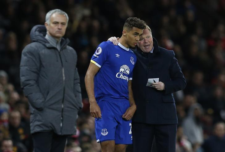Britain Football Soccer - Manchester United v Everton - Premier League - Old Trafford - 4/4/17 Everton manager Ronald Koeman speaks with Dominic Calvert-Lewin before he comes on as substitute Reuters / Andrew Yates