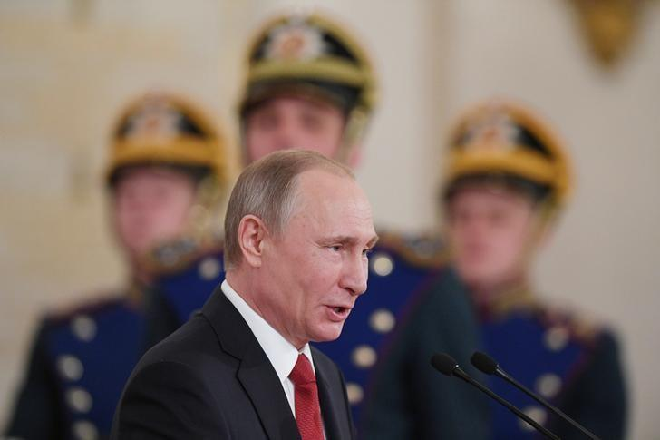 Russian President Vladimir Putin speaks during the State Prize awards ceremony marking the Day of Russia at the Kremlin in Moscow, Russia June 12, 2017. REUTERS/Natalia Kolesnikova/Pool