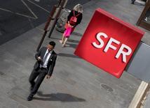 L'Autorité de la concurrence a autorisé mardi SFR Group à prendre le contrôle exclusif de NextRadioTV. /Photo d'archives/REUTERS/Philippe Wojazer