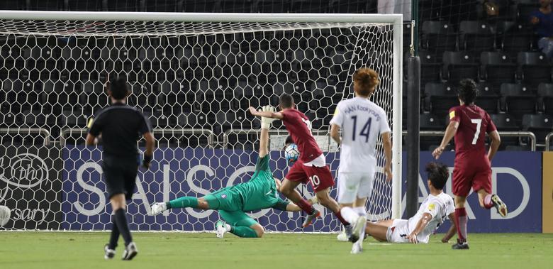 Football Soccer - Qatar v South Korea - World Cup 2018 Qualifiers - Doha, Qatar - 13/6/17- Qatar's Hassan Al-Haidos (C) scores a goal . REUTERS/Ibraheem Al Omari