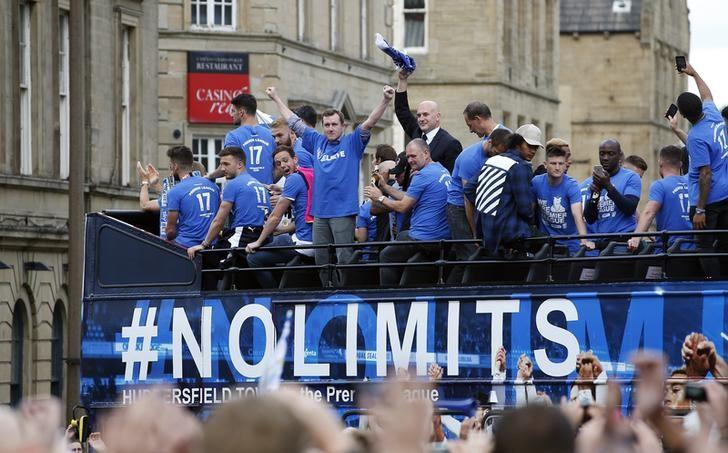 Britain Soccer Football - Huddersfield Town - Premier League Promotion Winners Parade - Huddersfield - 30/5/17 Huddersfield Town chairman Dean Hoyle celebrates on the bus during the parade Action Images via Reuters / Craig Brough/ Livepic/ Files