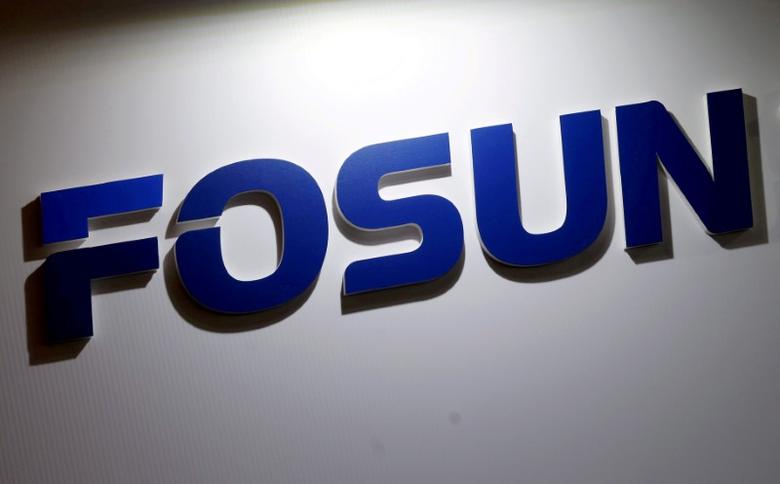 FILE PHOTO: A company logo of Fosun International is seen at the Fosun Fair held alongside the annual general meeting of the Chinese conglomerate in Hong Kong, China May 28, 2015.      REUTERS/Bobby Yip/File Photo