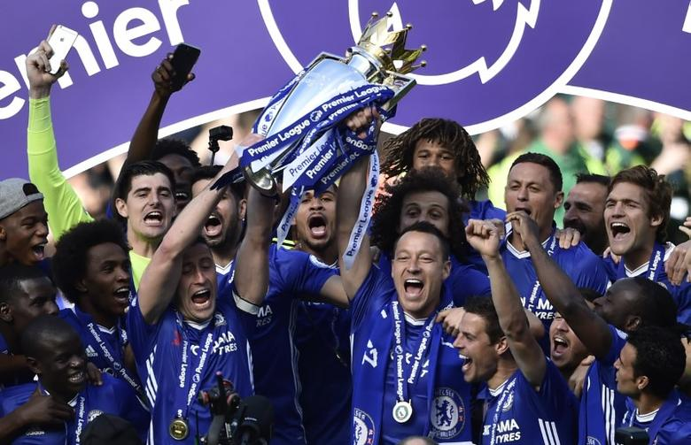 Britain Football Soccer - Chelsea v Sunderland - Premier League - Stamford Bridge - 21/5/17 Chelsea's John Terry, Gary Cahill and team mates celebrate with the trophy after winning the Premier League  Reuters / Hannah McKay Livepic