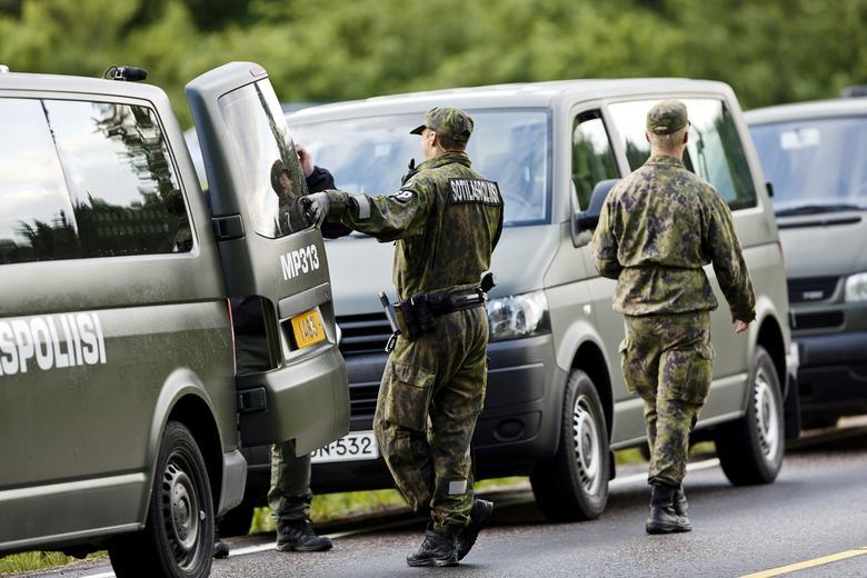 FILE PHOTO: Military police officers at the scene of a deadly shooting in Vihti, Finland June 18, 2016.  Lehtikuva/Roni Rekomaa/via REUTERS/File Photo