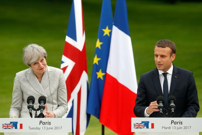 French President Emmanuel Macron (R) and Britain's Prime Minister Theresa May attend a joint press conference at the Elysee Palace in Paris, France, June 13, 2017.    REUTERS/Philippe Wojazer
