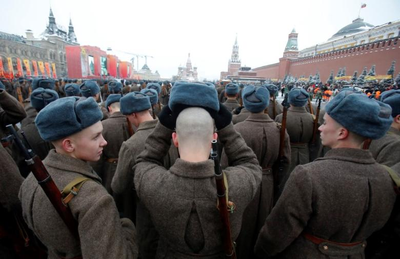 FILE PHOTO: Servicemen dressed in historical uniforms wait before a military parade marking the anniversary of the 1941 parade when Soviet soldiers marched towards the front lines of World War Two, in Red Square in Moscow, Russia, November 7, 2016.  REUTERS/Maxim Shemetov