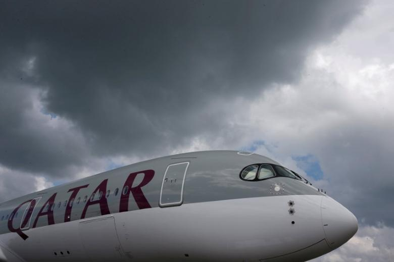 A Qatar Airways Airbus A350 XWB aircraft is displayed at the Singapore Airshow at Changi Exhibition Center February 18, 2016.  REUTERS/Edgar Su/File Photo