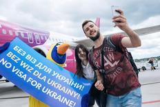 Passengers take a picture as they arrive from Kiev, after the European Union granted visa-free travel for Ukraine citizens at the airport in Gdansk, Poland June 13, 2017. Picture taken on June 13, 2017. Agencja Gazeta/Bartosz Banka via REUTERS ATTENTION EDITORS - THIS IMAGE WAS PROVIDED BY A THIRD PARTY. EDITORIAL USE ONLY. POLAND OUT. NO COMMERCIAL OR EDITORIAL SALES IN POLAND.