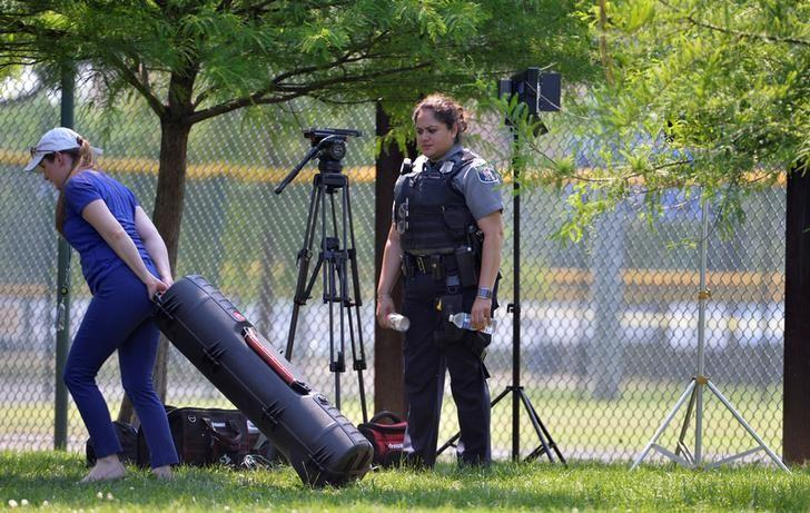 Police clear journalists from the outfield area of a baseball field where shots were fired during a congressional baseball practice, wounding House Majority Whip Steve Scalise (R-LA), in Alexandria, Virginia, U.S., June 14, 2017. REUTERS/Mike Theiler