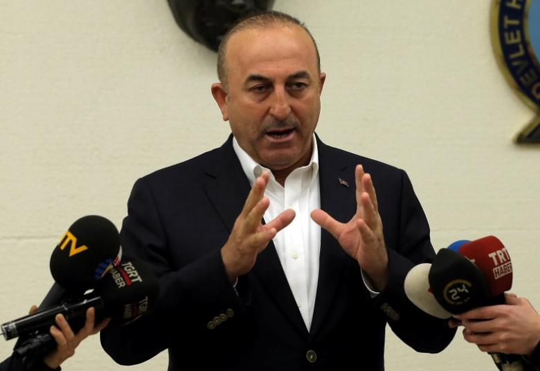 FILE PHOTO: Turkish Foreign Minister Mevlut Cavusoglu speaks during a news conference at Ataturk International airport in Istanbul, Turkey, March 11, 2017. REUTERS/Huseyin Aldemir/File Photo